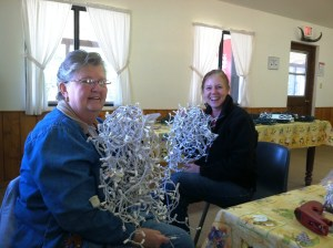 Trynette and Cheryl (wife of camp Director Dan)  going thru lites and more lites getting them ready to decorate the outside of the dining hall.
