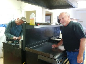 Don and Tony work at cleaning the griddle tops of the newly installed used stove and griddle.  Boy are those things HEAVY and a job to move!