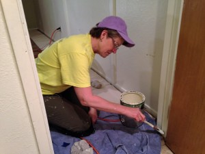 Jenny busy at it.  We repaired, caulked, refinished and painted five (5) complete rooms.