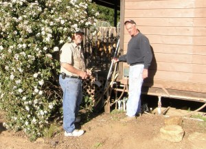 Dave and Don laying out and doing prep work(shoveling dirt and rocks) before building an accessible ramp to the office/admin building.