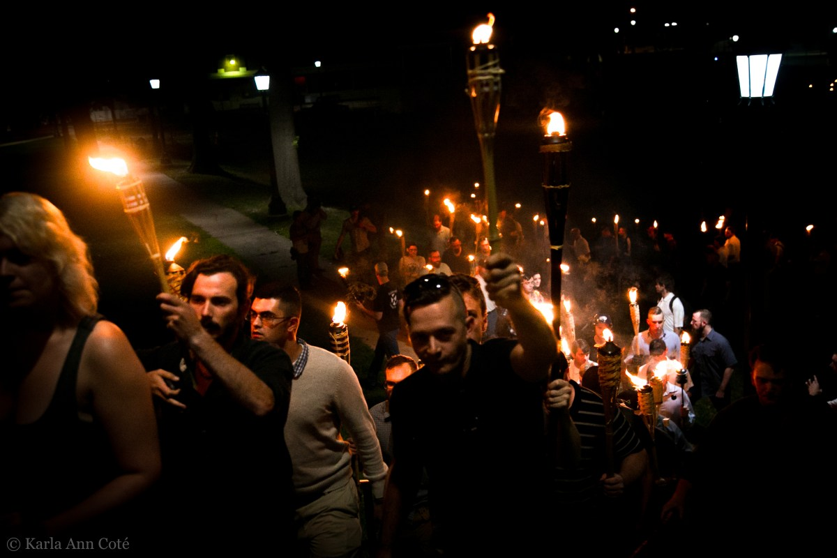 """A group of white nationalists marches in Charlottesville, VA as part of the """"Unite the Right"""" rally on August 11, 2017."""