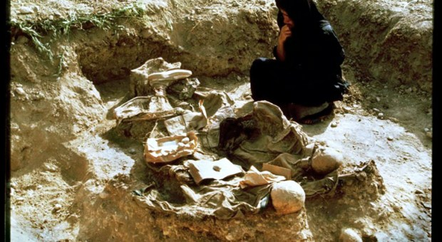 At a mass grave on the outskirts of Koreme in Iraqi Kurdistan, a woman mourns her brother and husband. Estimates of 60,000-80,000 people, mostly Kurdish, disappeared or were executed during the 1988 Iraqi Anfal campaign.