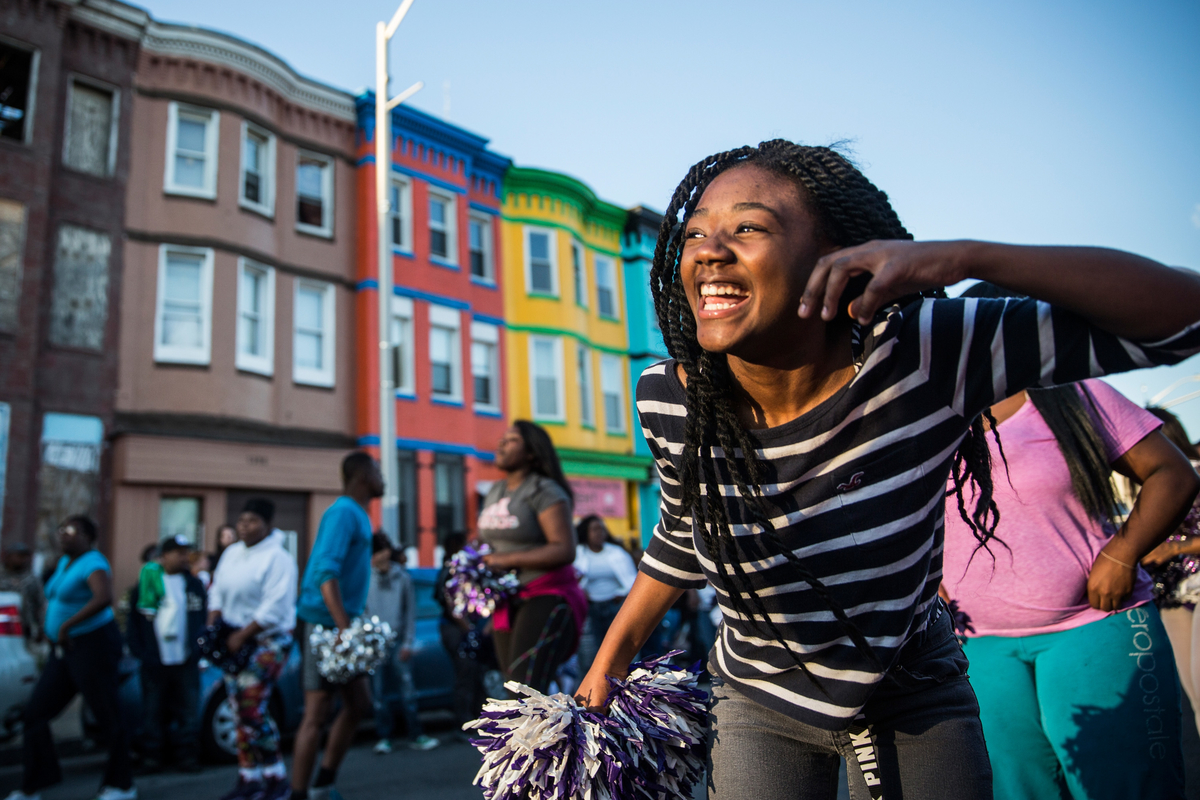 A girl dances to the beat of a drum line during a protest after the funeral of Freddie Gray, on April 28, 2015 in Baltimore, Maryland.