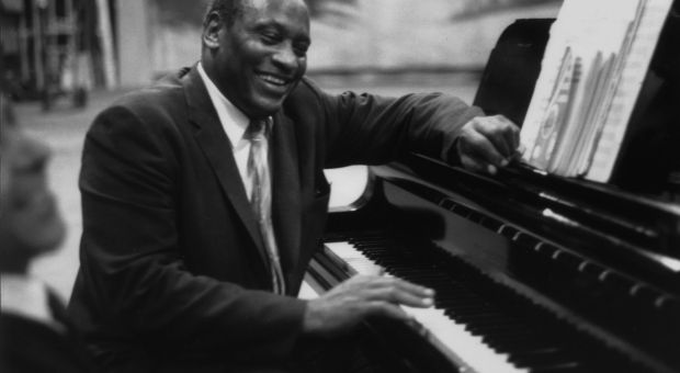 American singer, acclaimed actor of stage and screen, political activist, and civil rights campaigner Paul Robeson (1898 - 1976), rehearses at the piano.