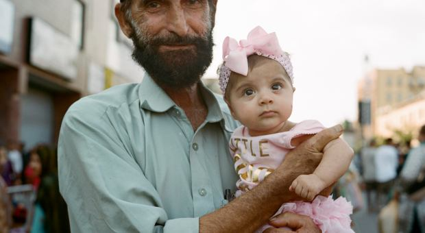 Image of bearded man holding adorable baby