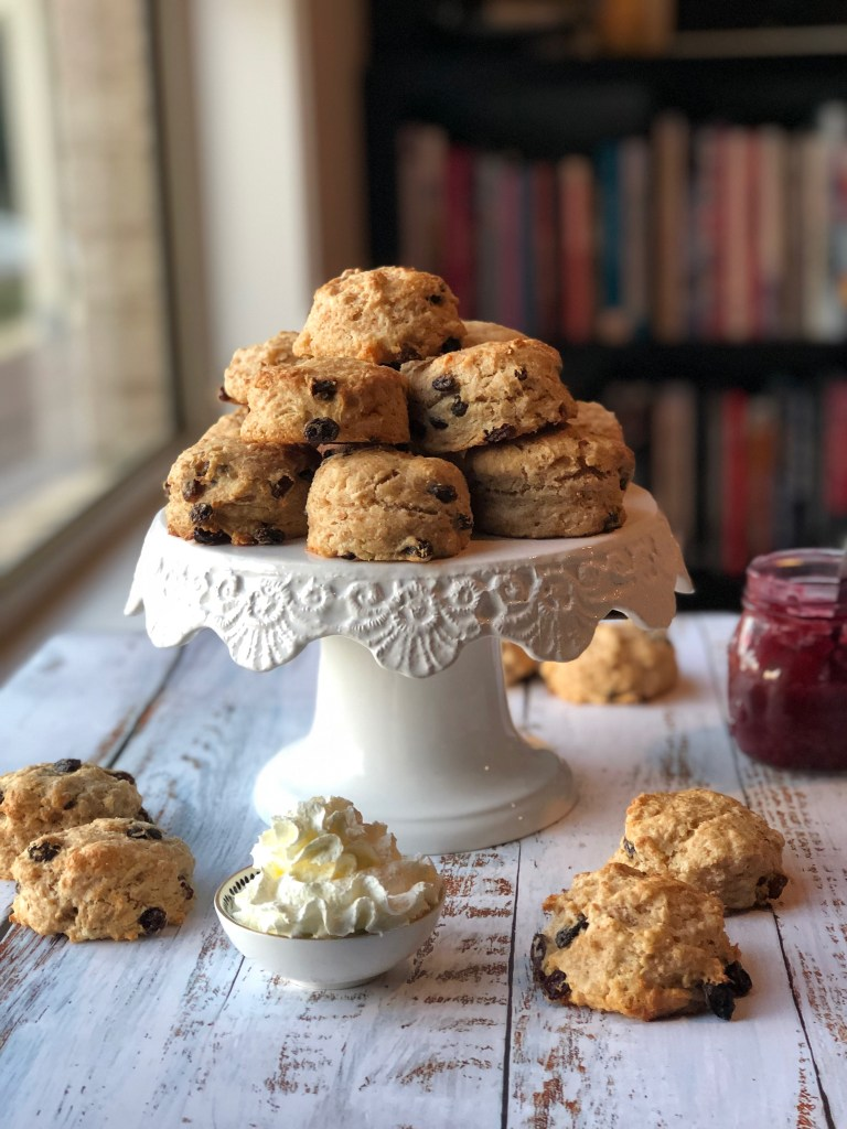 Spelt buttermilk scones stacked up on a cake stand.