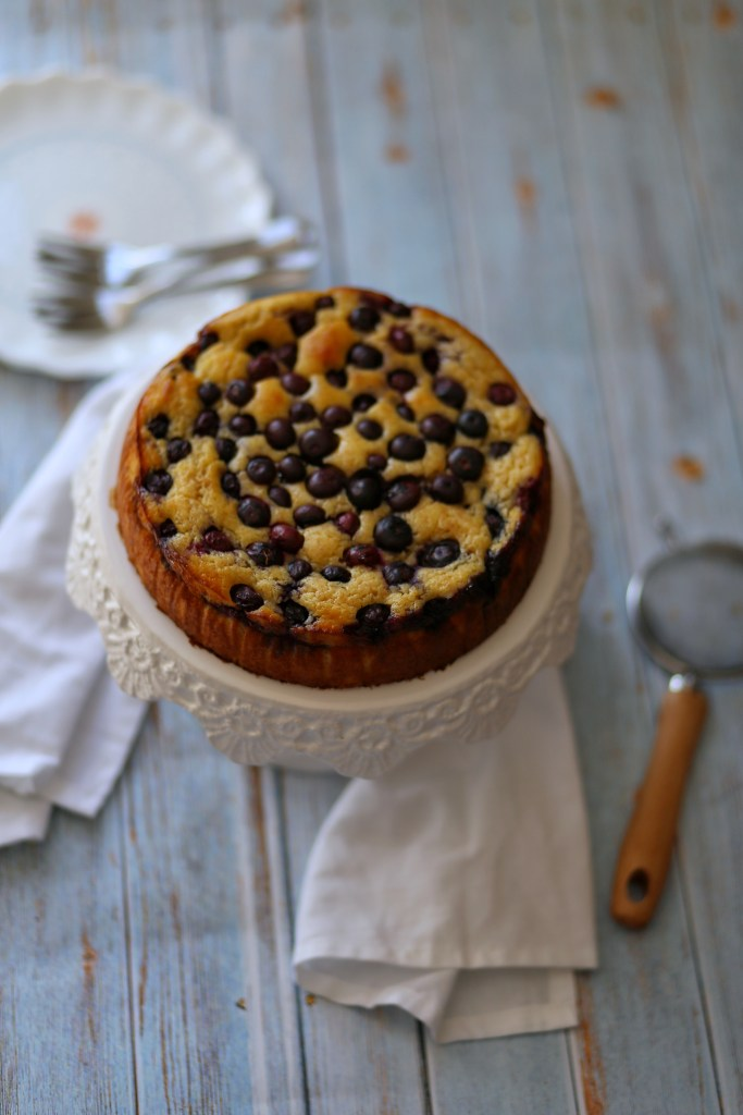 Healthy ricotta cake on a white stand.
