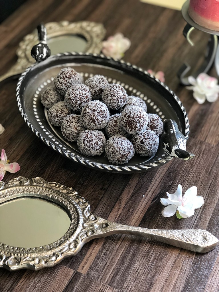 Orange chocolate bliss balls on a platter.