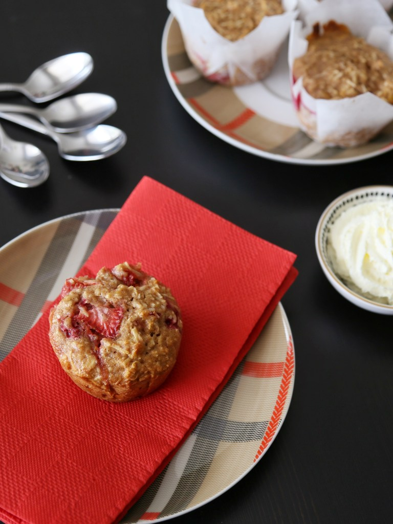 Raspberry coconut muffins on a plate.