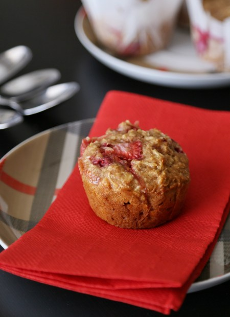 Raspberry coconut muffin on a plate.