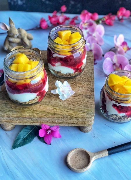Healthy cookie granola yoghurt pots in jam jars.