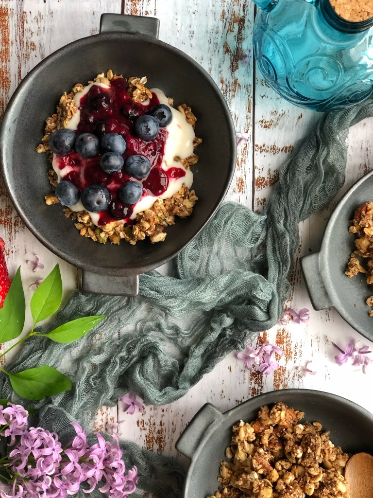 Supercharged healthy cookie granola in bowls.