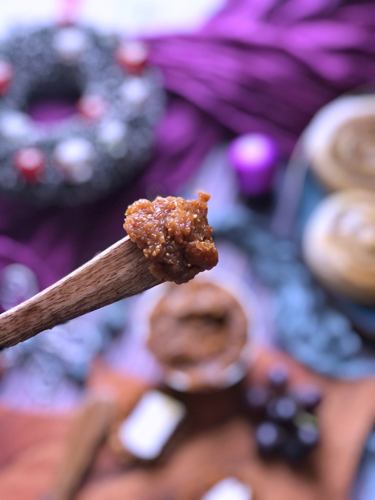Fig jam on the end of a wooden spoon.
