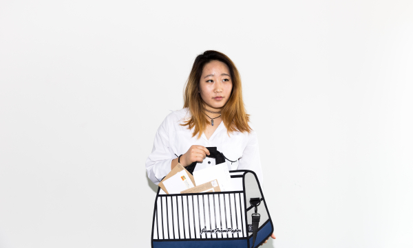 """""""The bag I'm holding is a) quirky and weird and delightful, which is something I take pride in in my personality and style, and b) filled with letters from my family. My family has supported me my whole life, and given me my own confidence that empowers me everyday."""" - Catt Kim #CELEBRATEWOMEN"""