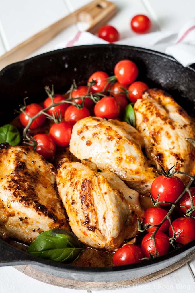 This one pan dish of chicken stuffed with salty, oozing mozzarella, sun dried tomato paste and basil, and served with vine roast tomatoes, is quick to make and totally delicious. Serve with fresh bread for a perfect summer dinner.