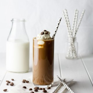 Glass of delicious cold brew coffee, topped with cream