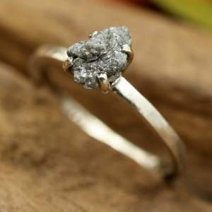 A raw diamond engagement ring from The Metal Studio Chiang Mai from their rough diamond collection