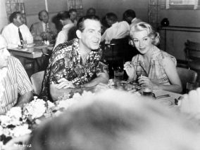 Jean Negulesco, Fred MacMurray and Lana Turner have lunch at the Fox commissary