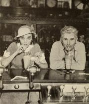 Zasu Pitts in the Universal Studios commissary in 1932 with director John Stahl