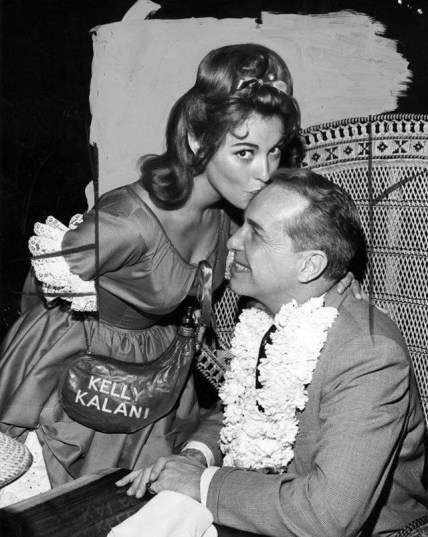 Sharon Tate presents Steve Crane, owner of a Beverly Hills restaurant, with a special St. patrick's Day Polynesian lei