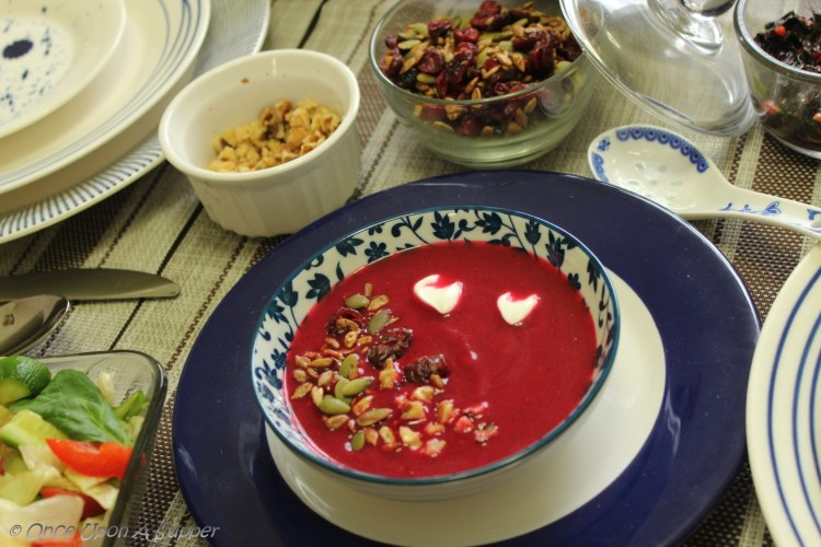 Soulful ABC soup — Apple, Beetroot and Carrot soup, topped with roasted seeds, dry cranberries and walnuts