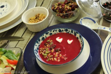 Soulful ABC soup -- Apple, Beetroot and Carrot soup, topped with roasted seeds, dry cranberries and walnuts