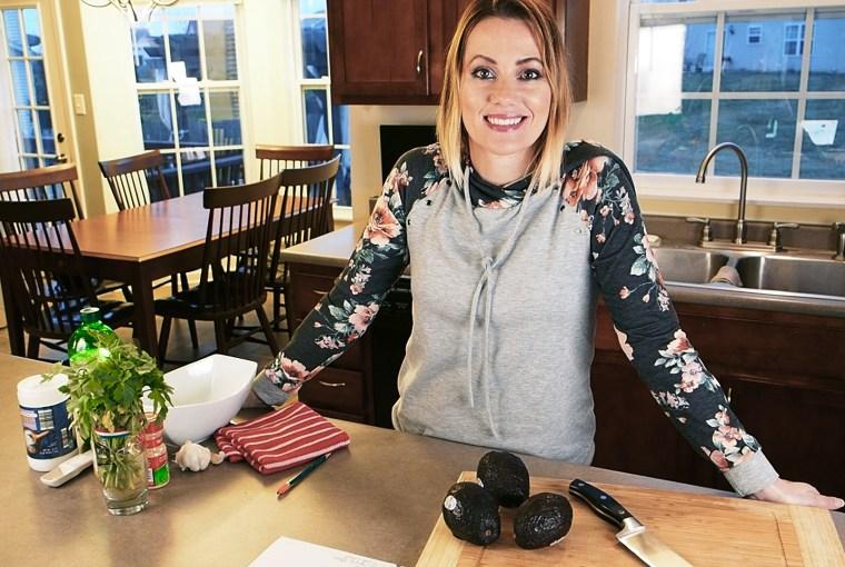 Terri Wheat prepping avocados for guacamole