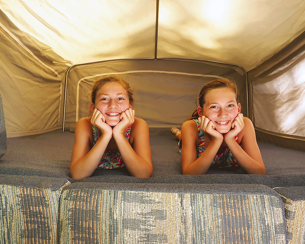 Camper with Wheat Twins Inside Pop-Up
