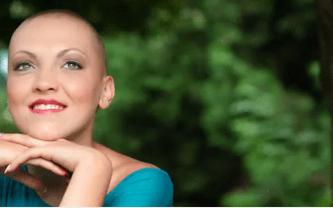 Woman with shaved head in forest
