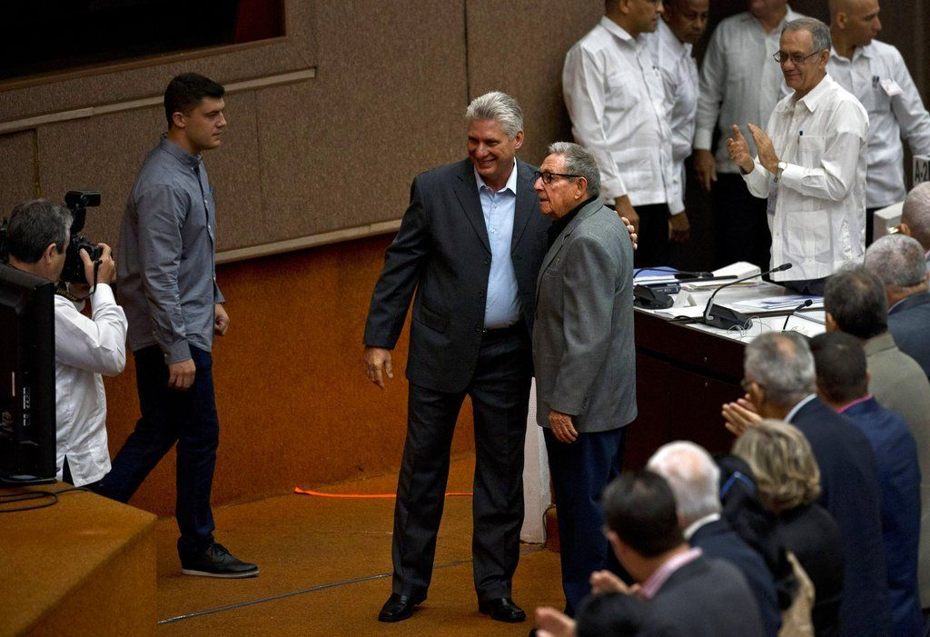Cuban President Miguel Díaz-Canel and former President Raúl Castro pose for a photo before the start of a session to discuss the draft of a new Constitution at the Havana Convention Center. Photo: Ramón Espinosa / AP.