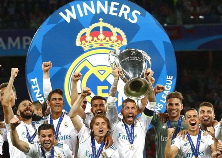 Real Madrid players celebrate after winning the European Champions League by beating Liverpool 3-1 in the finals in Kiev. Photo: Matthias Schrader / AP.