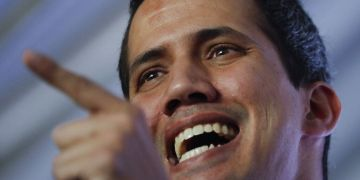 The self-proclaimed interim president of Venezuela, Juan Guaidó, talking during a meeting with experts in electricity in Caracas, Venezuela, on Thursday, March 28, 2019. (AP Photo/Natacha Pisarenko)