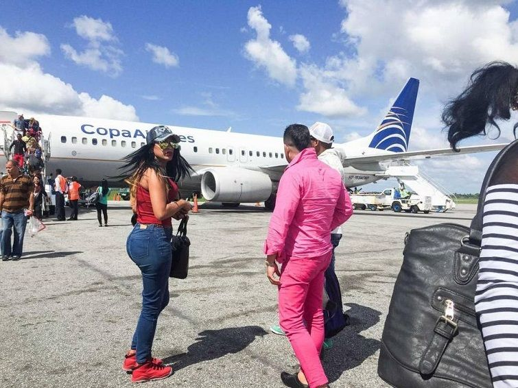May 13, 2016. Marta and Liset arrive at Guyana's Cheddi Jagan International Airport, where other Cubans will introduce them to the local coyotes. On the following day they will travel to the border with Brazil. Photo: Lisette Poole.