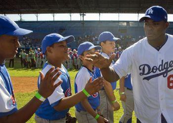 """""""Saber que futuros peloteros cubanos no tendrán que pasar por lo que pasamos, me hace feliz"""", dijo Yasiel Puig tras la firma del acuerdo entre la Federación Cubana y MLB. Foto: Ramón Espinoza/AP"""