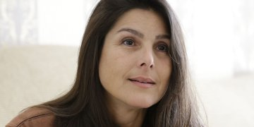 Judith Negrón, entrevistada en su casa. Foto: Terry Renna/AP.