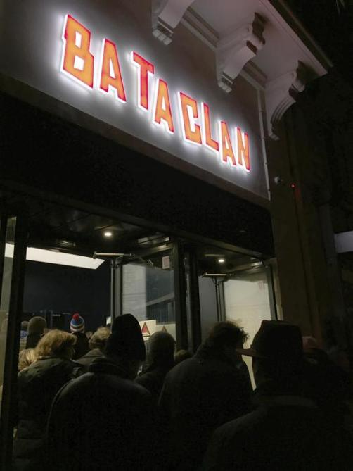 People are queuing outside the Bataclan concert hall in Paris, France, as they wait to attend a concert by Sting, Saturday, Nov. 12, 2016. A concert by British pop legend Sting is marking the reopening of the Paris' Bataclan concert hall one year after suicidal jihadis turned it into a bloodbath and killed 90 revelers. The coordinated attacks in Paris on Nov. 13 last year that also targeted bars, restaurants and the sports stadium, leaving 130 people dead. (ANSA/AP Photo/Christophe Ena) [CopyrightNotice: Copyright 2016 The Associated Press. All rights reserved.]