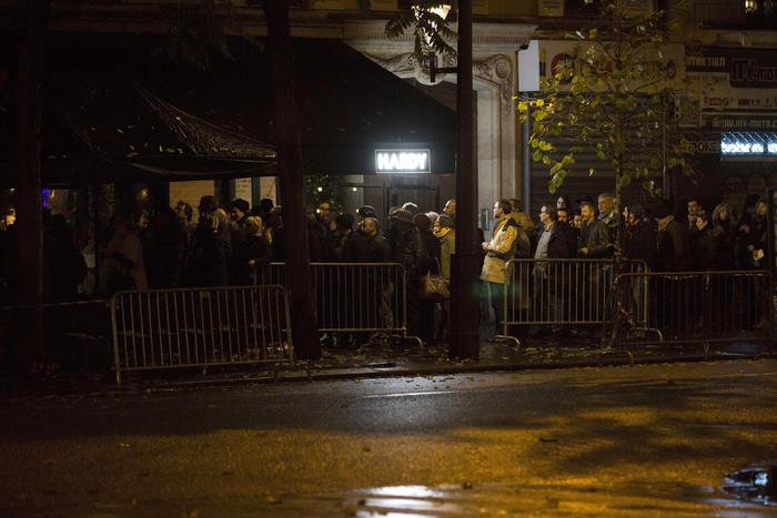People queue to enter the Bataclan concert hall in Paris, Saturday, Nov. 12, 2016. A concert by British pop legend Sting is marking the reopening of the Paris' Bataclan concert hall one year after suicidal jihadis turned it into a bloodbath and killed 90 revelers. The coordinated attacks in Paris on Nov. 13 last year that also targeted bars, restaurants and the sports stadium, leaving 130 people dead. (ANSA/AP Photo/Kamil Zihnioglu) [CopyrightNotice: Copyright 2016 The Associated Press. All rights reserved.]