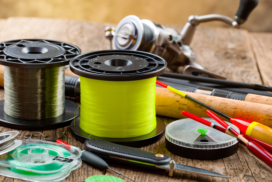 Fishing Tackle And Fishing Lines On Wooden Background