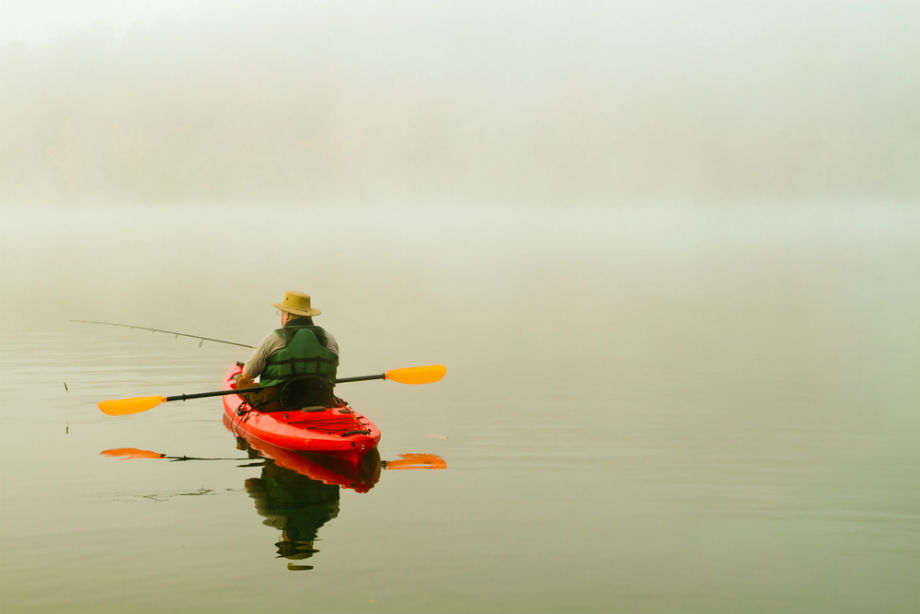 Man Fishing From Kayak