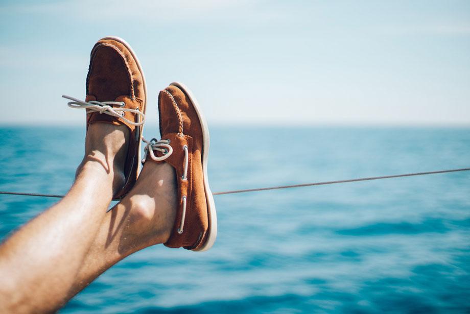 Feet Up On Boat Railing