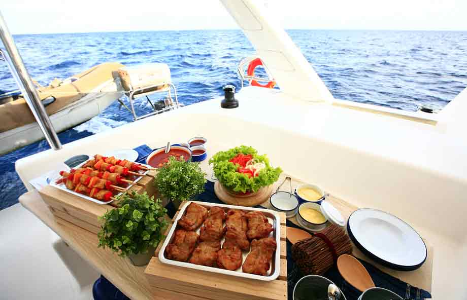 Table Of Delicious Food Prepared On A Boat