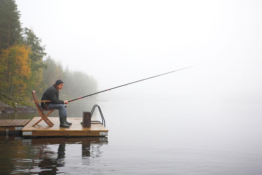 Man Fishing In The Winter