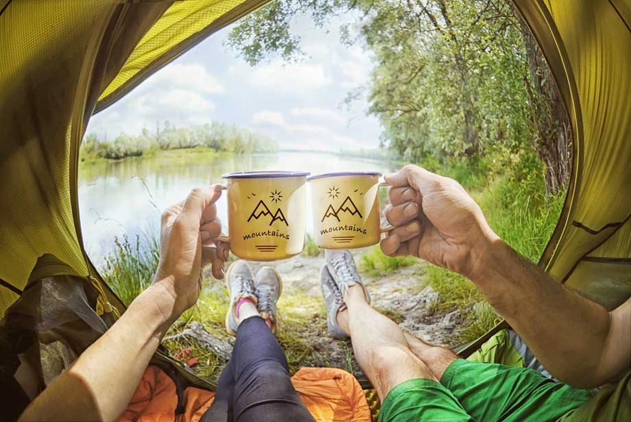 Two People Enjoy A Drink In A Tent