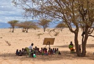 Hirkena Eysimbulyar teaches a pre-school class under a tree in the middle of the Kaisut Desert near Korr. Nick and Lyn Swanapoel with AIM have worked for 30 years in the hot, dry desert of Korr among the Rendille tribe in Korr, northern Kenya. It took 13 years to see their first convert. They realized at one point that literacy was the key to sharing Jesus and seeing people come to Christ. Literacy classes are held under trees in the middle of the desert, taught by women and men who themselves went through the literacy classes and became Christians. MAF has been a much needed service for the Swanapoels in this remote region.
