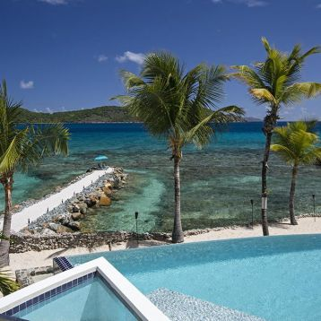 Slice of our rare Caribbean pool hugging hot tub