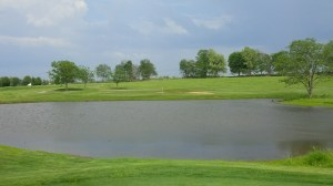 A view of the 1st green from the 9th tee across the pond.
