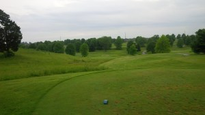 The gigantic, rolling, multi-tiered green rests way down the hill from the windsmacked 6th tee.