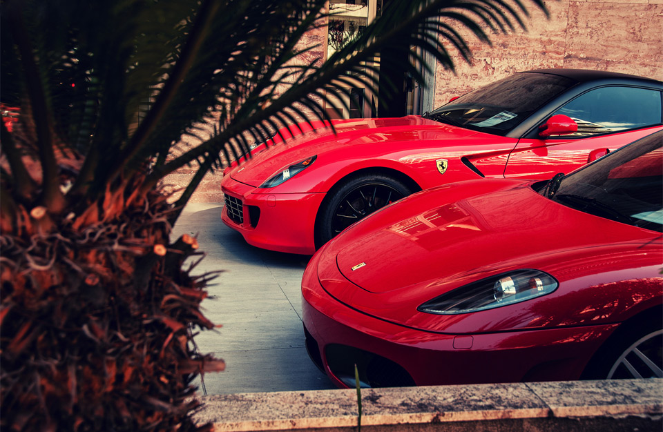 two red parked ferrari`s