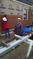 ELM staff working on a house at Habitat for Humanity