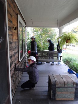 Volunteers with Habitat for Humanity on a porch